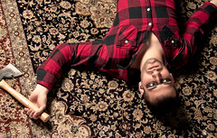 Timber (Stephanie Wesolowski) Tags: wood light red portrait people man black male guy boys face fashion metal digital photoshop carpet death eyes nikon pattern shadows upsidedown timber silk posed down aerial flannel rug textiles pocket oriental sprawl plaid ax grip retouch softbox checker lumberjack unbuttoned turkish strobe stubble