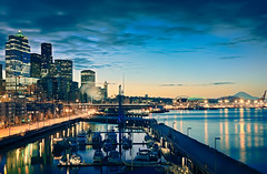 Urban Dreams In Blue (Sebastian (sibbiblue)) Tags: ocean seattle camera blue usa water skyline skyscraper aquarium harbor pier nikon waterfront harbour yacht citylights mountrainier rainier qwestfield safecofield bluehour nikkor dslr alaskanway bilora nikond40