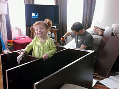HELPING DADDY assemble a desk.