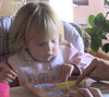 A girl eating potatoes (vidcap)