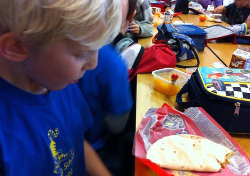 My son eats his taco