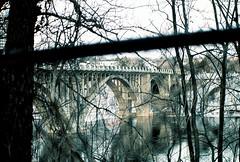 ford pkwy through fence and trees (pwners_manual) Tags: film 35mm bridges mississippiriver pentaxmesuper stp ektar100 industryandingenuity vivitar75205mm138