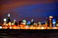 Chicago Skyline Photo 11Mar26_AC05186 (carlina999) Tags: city blue red orange lake chicago abstract blur beach water colors skyline night buildings aqua purple michigan dream magenta brokah geocity exif:focal_length=30mm exif:iso_speed=800 camera:make=nikoncorporation camera:model=nikond300 exif:make=nikoncorporation exif:lens=300mmf14 geostate geocountrys exif:model=nikond300 exif:aperture=20