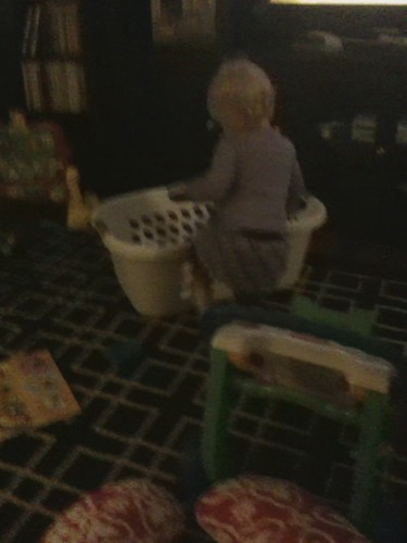Baby girl in laundry basket takes a tumble