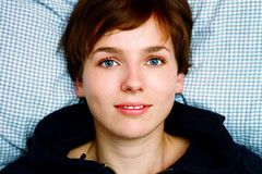 Lotta (Pillow Portrait Series) (hannes.trapp) Tags: blue portrait woman color girl beautiful beauty face canon mouth eos bed model eyes soft natural blueeyes pillow portraiture 7d shooting casual lotta nomakeup 50mmf18 natrlich hannestrapp img354941