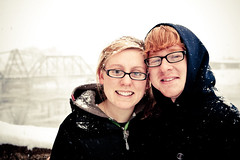 Peas in a Pod (Rudy Malmquist) Tags: bridge red woman snow storm man tree male female river glasses ginger couple head michigan drew grand andrew rapids hoody blonde teresa snowing lorraine treesap malmquist koszulinski
