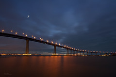 Coronado Bridge Twilight (Lee Sie) Tags: ocean bridge sky orange moon clouds port marina lights bay downtown traffic coronado bayfront bluered pfa sandiegowater
