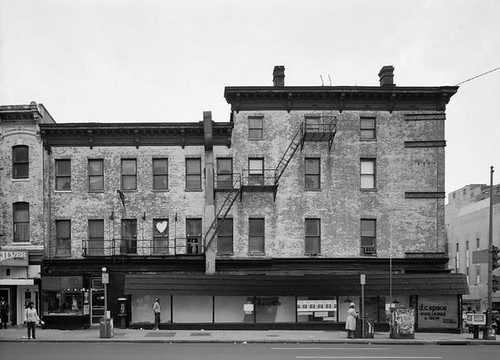 a building on 7th St in the 1970s (by: Anice Hoachlander for the Historic American Buildings Survey, public domain)