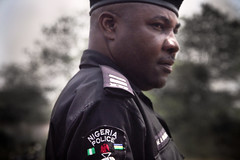 Seize (mowunna) Tags: africa portrait people soldier person war gun force african police security civil weapon nigeria policeman protect seize nigerian strife