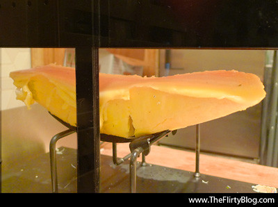 raclette-machine-melting-cheese