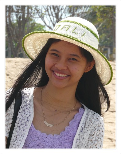 Girl with Bali hat .