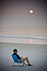 Pensive (ScottJphoto) Tags: blue sunset beach chair solo lonely retired retirement wrightsville beachcombing beachcomber lonesome wrightsvillebeachjulyameliaguswidener
