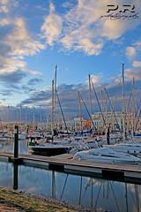 Puerto (l) (Pablo  Ronald) Tags: sunset sky espaa water boats atardecer spain agua barcos huelva cielo farol seda ayamonte bunes relfejos relfects casashouses pabloronald