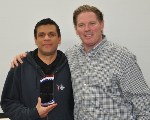 Walter Avelar, Manager of the Year poses with Chris Fox, Minutemans President