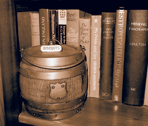 Old wooden biscuit barrel and books by French Tart