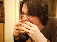 Eating a rather delicious burger.