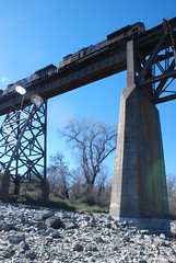 6530 Pushin south (huntingtherare) Tags: railroad trestle bridge train bench graffiti freight benching