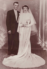 A 1950s wedding photo - Strands Studio of Rugby, North Dakota (thstrand) Tags: flowers woman brown man men history fashion sepia portraits print photography groom bride women couple married veil rugby portait fulllength marriage american 1950s northdakota backgrounds n