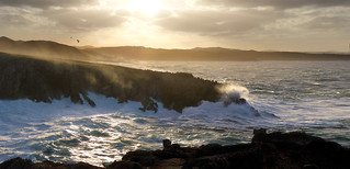 Strong Tramontana wind vapours sea out over rugged Menorca
