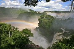 Rainbow over the Falls (Alex E. Proimos) Tags: world park travel wallpaper brazil love argentina beauty animals clouds spectacular wonder amazing rainbow heaven peace open place flood time god side like visit falls special national wikipedia once capture incredible iguazu geographic iguassu lifetime somewhereovertherainbow iguacu proimos