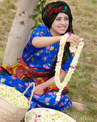 Arabian Vendor Jasmine (Khalid Alkainaey  ) Tags: life travel people woman tourism girl beauty face image muslim islam picture middleeast arab yemen arabian sanaa aden   yemeni yaman      ymen  yemenia  jemen  arabiafelix     arabianpeninsula iemen           yemenphotos     republicofyemen     yemenpicture    lifeandpeople   yemeniamagazine  traditionalcostumeofyemen yemenimages  inyemen
