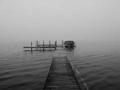 Into The Mist B&W (Christopher0917) Tags: blackandwhite bw mist lake water monochrome misty fog docks grey infinity gray foggy upstatenewyork infinite westernnewyork chautauqua chautauqualake maplesprings chautauquacounty maplespringsny