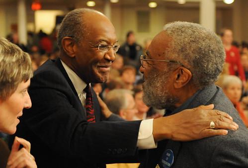 Reverend Jim Forbes (L) hugs Dr. Vincent Harding (R)
