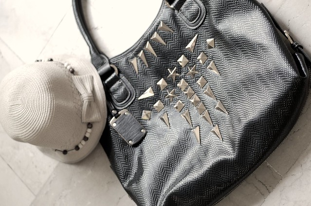 summer hat and studded leather bag