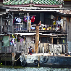 The Chao Phraya (Ed Kruger) Tags: house water river thailand fishing asia bangkok poor chaophrayariver earthasia edkruger chaopray