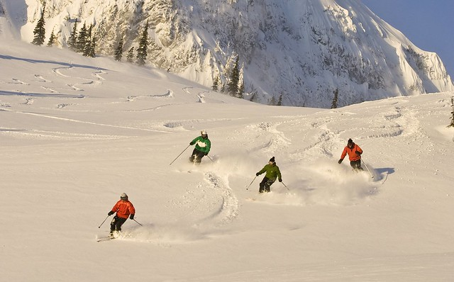 Group of skiers enjoying new snow