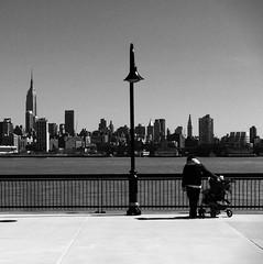 Tripartite view (Ryan Vaarsi) Tags: newyorkcity people blackandwhite skyline cityscape hudsonriver empirestatebuilding iphone 2011 flickraward iphoneography