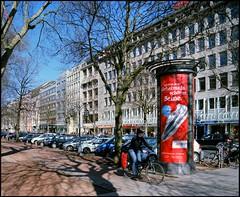 (Hans van Reenen) Tags: film mediumformat germany deutschland cyclist cine düsseldorf kodakportra160vc niederrhein arbolitos koenigsallee pentax67 silkypixpro canoscan9000f 20110319 pentax6x745mmf4