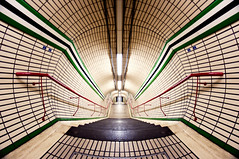 Tottenham Court Road (martinturner) Tags: road green london lines station court underground point angle tube wide stripe tunnel symmetry fisheye dizzy 8mm vanishing leading tottenham tfl samyang martinturner welcomeuk