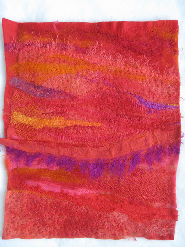 red needle felted piece with stitching