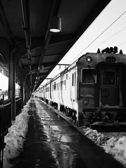 track, one (ho_hokus) Tags: railroad winter bw snow monochrome station train newjersey platform nj railway olympus passenger kodakbw400cn mjuii hoboken terminus njt