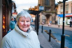 Sarah (TGKW) Tags: road street old portrait people white bus lady high expression coat stop jacket elderly cheekbones ayr 7099