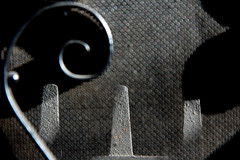 110130a (Tom Wachtel) Tags: shadow black metal dark grate grey iron gray cast hearth swirl curl