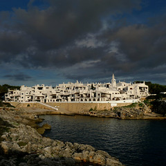 Whitewashed dwellings and Moorish arches of Binibeca Vell (Bn) Tags: houses white streets colour church geotagged islands fishing europe day village christ little cloudy harbour arches tourist resort unesco patio moorish maze picturesque topf100 cultures narrow menorca binibeca mediterraneansea alleys whitewashed popularculture balearic viewport binibquer sunsoaked 100faves binibecavell saariysqualitypictures geo:lat=39823073 geomenorca geo:lon=4229307 antoniosintes