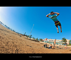 Rest over the beach (iPh4n70M) Tags: blue sea sky mer beach kids photography fly photo jump nikon photographer photographie down fisheye bleu ciel morocco photograph maroc tc vol 16mm plage saut lay couché photographe essouira nohdr d700 tcphotography ph4n70m iph4n70m tcphotographie