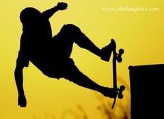 Jump in the light- bahrain (SAAD AL_FARHAN) Tags: black bahrain nikon grand prix 28 kuwait yallow 2010 400mm سنه 2011 تصوير الكويت البحرين الكويتي اسود kowait اصفر المصور خطره لون رياضه سيلويت kewait d3s هوايات سكيت رول الفرحان سغد 2xiii