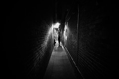 The Meeting (TheFella) Tags: canon eos 500d photo photograph europe uk unitedkingdom london capital gb greatbritain england westminster night nighttime lowlight dark darkness urban city street alley alleyway people meeting black white blackandwhite bw filmnoir moody secret bricks lights shadow soho seedy eerie lamp dwcffurban