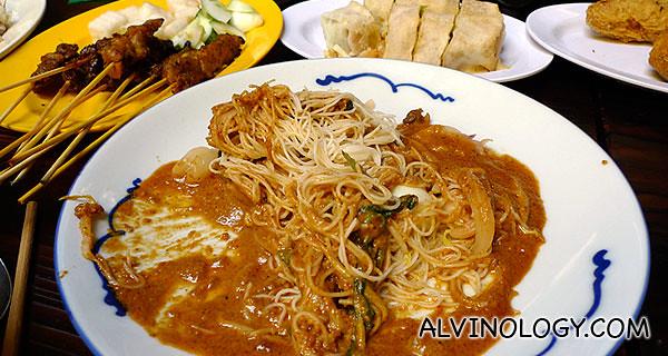 Satay, satay bee hoon, popiah, lots of food keeps piling on the table