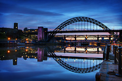 Tyne Bridge at Twilight (Chris Lishman) Tags: blue sky panorama reflection water night canon river newcastle landscape lights evening twilight sundown dusk tyne gateshead tynebridge hdr newcastleupontyne quayside manfrotto waterreflection rivertyne newcastlequayside lowlevelbridge lishman exposureblend riverscene canon7d exposurefusion chrislishman tynebridgeattwilight