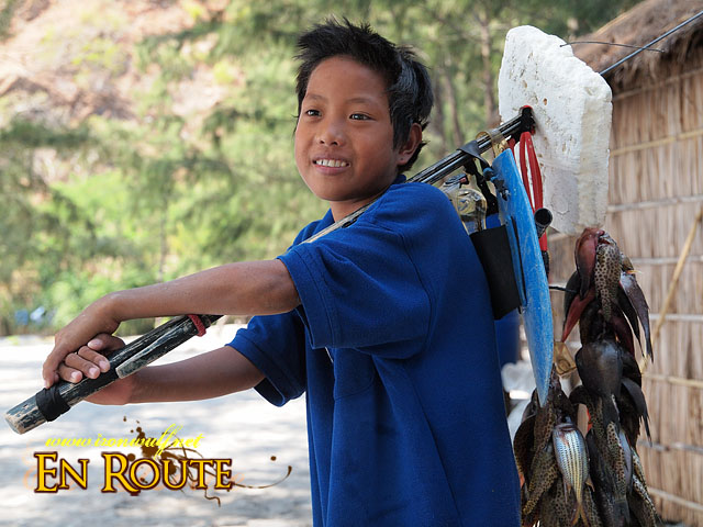 A Child Spearfisher with his day's catch