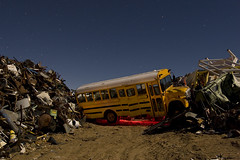 Swept Away (Lost America) Tags: lightpainting night crash debris fullmoon junkyard schoolbus wreck startrails recycler nocturnes