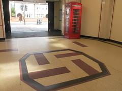 Sanskrit symbol for good luck. (maggie jones.) Tags: london lu tfl swastika floor tile k6 phone box red entrance