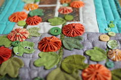 Hollyhocks (PatchworkPottery) Tags: quilt applique yoyo yoyos freemotion mini patchwork handmade crafts hollyhocks floral buttons window wallhanging
