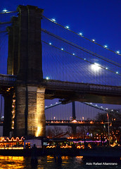 Moon over the River Café (Rafakoy) Tags: city bridge light sky urban moon newyork color colour reflection colors brooklyn night digital reflections river lights restaurant photo high cafe colours with image photos dusk picture taken images iso brooklynbridge manhattanbridge eastriver sample late samples nite 2000iso therivercafé afsnikkor18105mmvr nikond7000