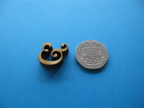 tiny wooden ampersand