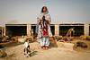 Baby goats and buffalo (Lil [Kristen Elsby]) Tags: unicef pakistan portrait woman topv2222 buffalo asia village goat goats sindh shalwarkameez southasia environmentalportrait sindhi environmentalportraiture jamshoro